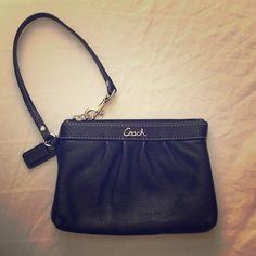Black Coach wristlet Soft leather, no scratches or visible wear. Coach Bags Clutches & Wristlets