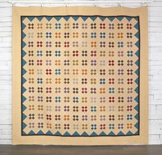Marcus Fabrics Paula Barnes Companions Four Square Quilt - White.   Nine patch set on point.