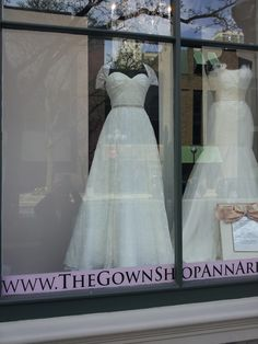 """IVY & ASTER """"OH JOY"""" IN THE WINDOW OF THE GOWN SHOP."""