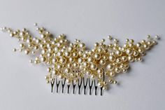 Bridal hair comb ivory and gold  - Crystal rhinestones & glass crystals - Ceramic pearls - Approximately 7 in length, 2 1/2 in width not including comb  COLOR: gold with your choice of White or Ivory pearls  Delivery At the moment the time of delivery Europe - 7-20 days U.S. 14-30 days Australia - 2 - 4 weeks All accessories are carefully packed for dispatch. .  Informtsiyu to order When purchasing items, please specify in the order comments: 1 - the date of the wedding!!!!!!!! 2 - s...