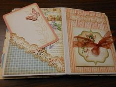 Book - Great ideas on decorating pages. I love how they used the embellishments on the pages. Memories & More Classes: Secret Garden Mini Album, with Bonnie