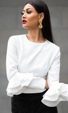 gold floral earrings + white ruffle sleeve blouse + black skirt