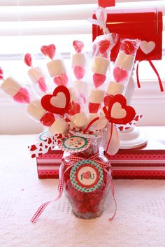 Cute homemade Valentine idea - marshmallows and heart candies on a kabob stick. Just need some cellophane from Michaels and a cute printout tag.  Easy!