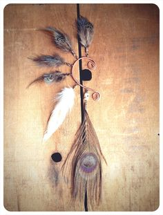 mystic a tribal feathered ear cuff by RunWithTheTribe on Etsy, $37.00