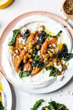 Roasted Carrots and Chickpeas seasoned with za'atar and served over Greek yogurt with lemony kale makes a wonderful side dish or meatless main! #plantbased #yogurtbowls #vegetarian #carrots #chickpeas