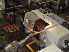 The Automation in Haas Automation - repetitious heavy work in #CNC done by #robot. Good use of robot.