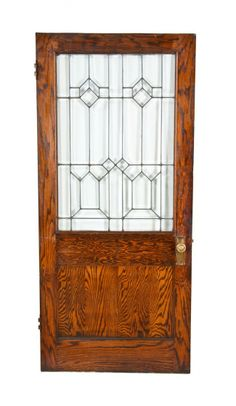 Incredible early 20th century American exterior residential varnished white oak wood entrance door with strongly geometric all-beveled glass window. #entrancedoor #glasswindow #oakdoor #varnished