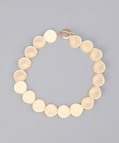 Take a look at this Gold Matte Hammered Disk Necklace by Alexa Starr Jewelry on #zulily today!