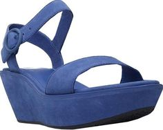 Camper Women's Shoes in Blue Leather Color. Step out in style wearing the Damas Wedge Sandal from Camper. This platform wedge is sure to elevate your look with its sleek construction. An adjustable strap across the top ensures a customized fit.