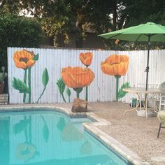 My version of a fence mural for Granny's pool fence!  It was fun to do!  #fencepainting #fencemural #paintedfence