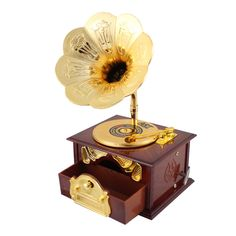Deliver the perfect gift with this classy replica Record Player musical jewelry box. The record on top spins around just like a real record player as it plays the lovely Beethoven's 'Fur Elise', start