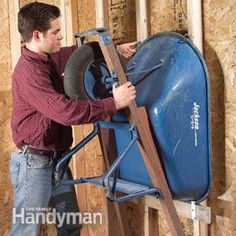 Wall storage saves floor space  wheelbarrow storage, garage organization