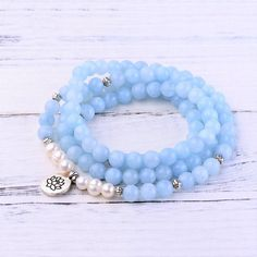 """Gemstones: Grade """"A"""" Aquamarine Stone Size: 8 mm Mala Length: 36 inches & inches This bundle features: Aquamarine Throat Chakra Mala Aquamarine Throat Chakra Bracelet Beaded Earrings, Beaded Bracelets, Chakra Jewelry, Throat Chakra, Chakra Stones, Pearl White, Let It Be, Gemstones, Pearls"""