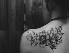 flowers tattoo on back shoulder black and white
