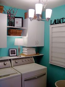 Front Loading Washer Dryer Set Into A Cabinet With Doors