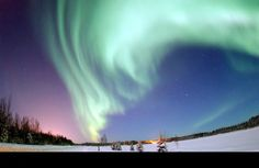 "Aurora Borealis - what makes this happen? - combination of solar wind, magnetic fields, electrical currents, and at least one person standing around to go, ""Oooohhhh. Aaaaahhh."""