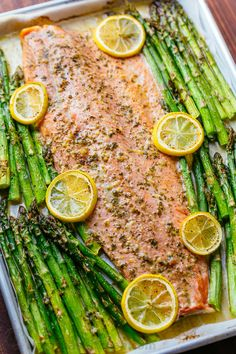 One Pan Salmon and Asparagus with Garlic Herb Butter is quick and easy (25 minute meal). The garlic-herb butter gives this salmon and asparagus rich flavor.   natashaskitchen.com