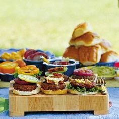 Try a gourmet burger bar with toppings like avocado, artisan pickles, and sliced mozzarella at your next summer party  #summer #party #grillout