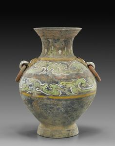 """Han Dynasty Pottery (Hu) Vase _ colorful elaborately painted design, loose ring handles at the shoulder _ pigments probably later, loose rings probably later _ rim chips and some wear; H: 151/2"""""""