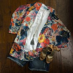 Floral kimono adds beautiful color to jean shorts and white blouse. Looks great with tassel necklace.