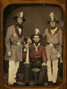 This is a very early picture of fire fighters. The picture was taken in 1855, and it shows three members of the Phoenix Fire Company of Charleston, South Carolina.
