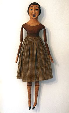 folk art/ primitive....i love the way the arms and legs are jointed....so simple.