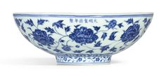An exceptional and brilliantly painted large blue and white 'peony' bowl, mark and period of Xuande (1426-1435). Estimate 2,500,000 — 3,500,000 HKD. Unsold. Photo Sotheby's.   sturdily potted with shallow rounded sides rising from a slightly tapered foot, the exterior painted in rich and strong cobalt blue with eight large herbaceous peony blooms borne on a meandering leafy scroll, between a double-line border and a band of upright lappets, the footrim encircled by an undulating floral…