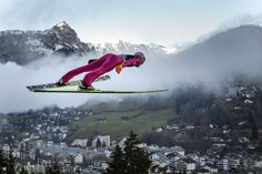 This photo of a ski jumper really interested me because of the background with the town, fog and mountains. Engelberg, Iron Mountain Michigan, World Cup Skiing, Fis World Cup, Nordic Combined, Ski Jumping, Sports Photos, Winter Olympics, Winter Is Coming