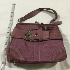 Coach His is an authentic coach handbag. This is limited edition. It is purple it is signature style C's. There is a Beverly bow with rhinestone. Leather trimming. There is signs of wear however still great. Comes with a dust bag. Coach Bags