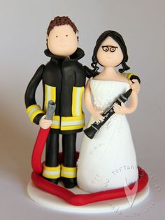 Feuerwehr Klarinette Brautpaar Tortenfigur für die Hochzeitstorte - Hochzeitstortenfigur - Weddingcake - Caketopper - Weddingcaketopper - Tortendeko - Hochzeitsideen - Weddingideas von www.tortenfiguren.at