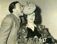 Gracie Allen had Lilly Dache cook up a pie hat creation just in case she had to eat her hat. George Burns samples it. 5/15/1940 from circulating collection, publicity stunts