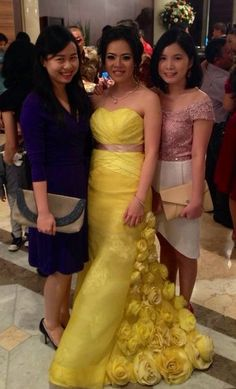 Our special project dress (middle, yellow) and our iconic Cindy Dress (right). They both look stunning!