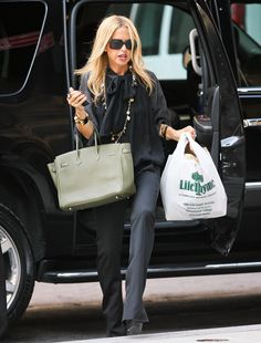 Before Rachel Zoe began designing her own accessories, she was known for carrying countless Hermes items. I love this muted olive green Birkin.
