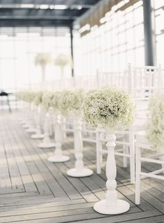 All-White Wedding Ceremony: White Chairs & Baby's Breath Arrangements Along The Aisle
