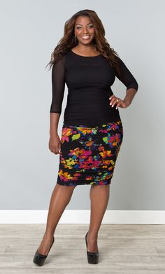 I love pops of color on black for the salon. -SL  Sure a floral skirt is feminine and sweet, but it can also be bold and beautiful like our plus size Rhapsody Ruched Skirt.  Vibrant colors pop on the black background and the ruching flatters all your curves.  #KiyonnaPlusYou  #Plussize  #Kiyonna  #MadeintheUSA
