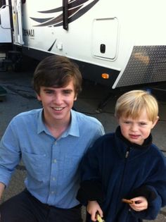 Freddie Highmore with little Norman