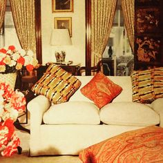 The drawing-room of 'Graycliff,' Nassau, the Countess of Dudley's island house. Do aristocrats have a sense of humour? Milady's sofa cushions are fake hamster. The Chinese screen is 18th-century; plump paisley floor pillows abound as do carnations & old family portraits. The curtains are heavy and perhaps more suited to a cold clime but they keep that powerful island sun at bay. Horst, 1971.