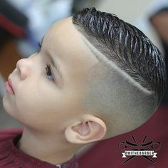 slick haircut with a quiff (little one), and not much else
