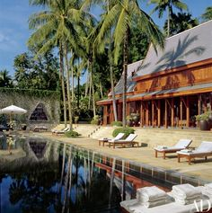 """Designer Ed Tuttle worked with Adrian and Bebe Zecha to create a private residence within the couple's Amanpuri resort on Phuket, Thailand. """"Its roots are really developed from the Ayutthaya period of architecture,"""" Tuttle says. The main sala, or pavilion, overlooks a swimming pool and the sea   archdigest.com"""