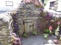 Holy Well in the centre of Crantock village in Cornwall