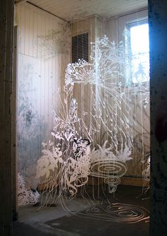 Chris Natrop's room installation of fern like cut paper forest.