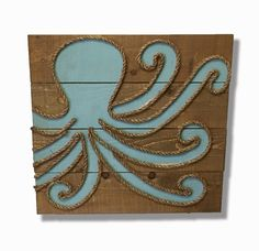 Original, one of a kind, rustic wall art featuring rustic wood, rope and paint shaped into an octopus. Signed by the artist and ready to hang on in your covered porch or lanai. Free shipping on this i