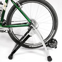 Ride your bike indoors with this portable stationary bike attachment.