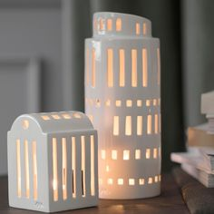 Kahler Urbania Tarn light house is a tall, round tower is inpired by our creative modern buildings and silhouettes popping up in our cities. Each Tarn light house has individually cut windows for its own unique look. Tarn will glow beautifully and will