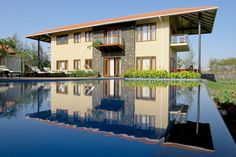 Nashik-based Environ Planners chisel a built form that snuggles amidst nature as a resort-esque second home. Check it out and leave us your comments… Residential Architecture, Landscape Architecture, Interior Architecture, Site Face, Green Landscape, Interior Styling, Swimming Pools, Farmhouse, Mansions