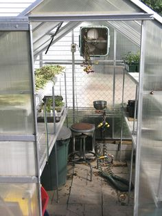 site on adding shelving made from wire closet shelves to your Hobby Greenhouse Small Greenhouse Kits, Pvc Greenhouse, Greenhouse Supplies, Greenhouse Growing, Greenhouse Gardening, Greenhouse Ideas, Greenhouse Shelves, Greenhouse Wedding, Plant Watering System