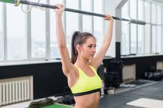 2. Do a Standing Barbell Press at 60 Percent of Your Body Weight