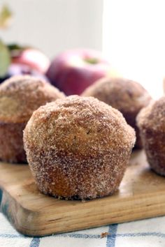 These melt-in-your-mouth whole wheat apple cider donut muffins are brushed with butter and rolled in cinnamon and sugar after baking. YUM!