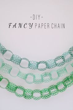 Easy DIY fancy paper chain!   Using a patterned hole punch makes this look so much more ornate than basic paper chains.