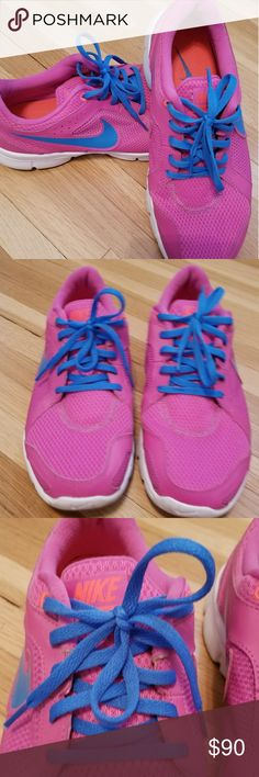 Nike Running Shoes Practically New Size 10.5 Bought these running shoes when I thought I was going to start working out :p they are Nike size 10.5 bright pink and blue, will definitely catch your attention. Great shape, I used them maybe twice. Nike Shoes Sneakers